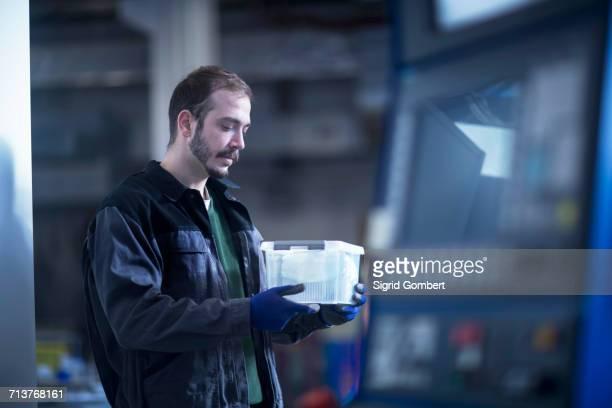 engineer carrying plastic storage box - sigrid gombert stock-fotos und bilder