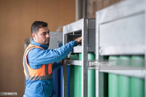 engineer checking gas cylinders - tank stock pictures, royalty-free photos & images