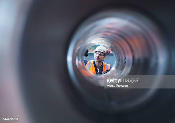 Engineer checking steel part in engineering factory