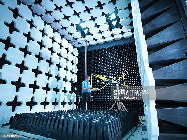 engineer checking the bilog antenna set up for electromagnetic compatibility (emc) radiated emissions in anechoic chamber with energy absorbers - ingenieurwesen stock-fotos und bilder