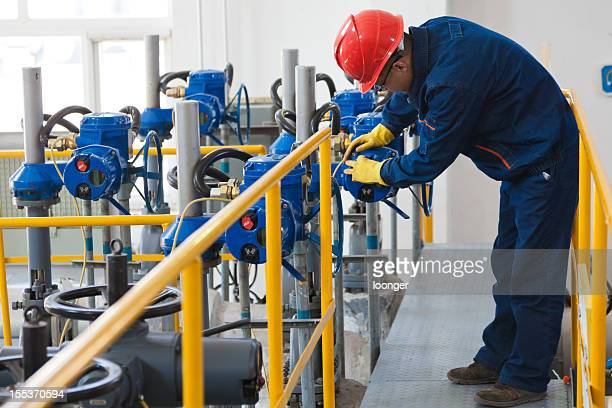 Engineer checking the oil pipeline equipment