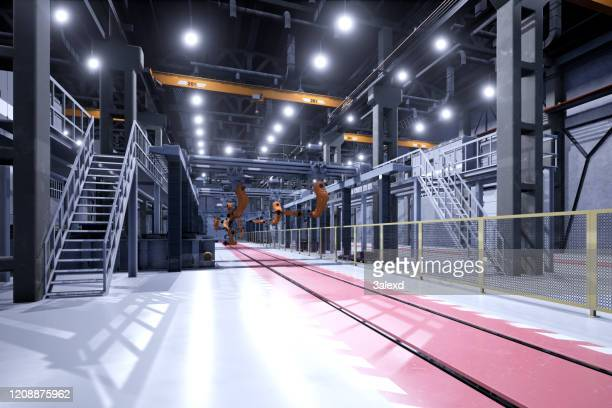 engineer control robots in factory of future - robot stock pictures, royalty-free photos & images