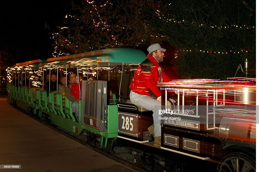 engineer david rector drives the ninth annual christmas train ride in irvine regional park rides - Irvine Christmas Train