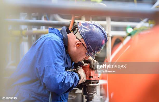 Engineer drilling during power station outage