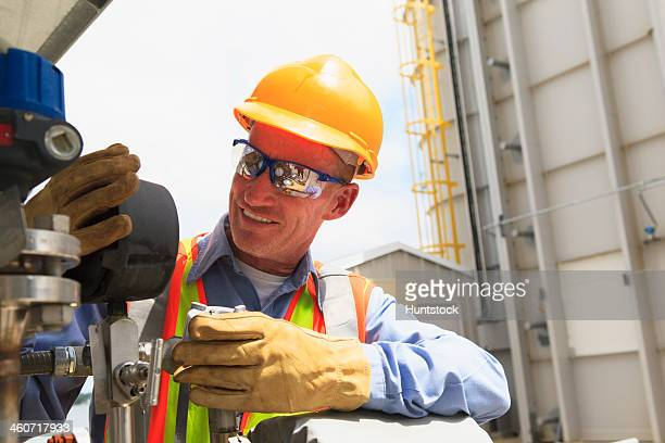 engineer examining transducer gauge at electric power plant - pressure gauge stock photos and pictures