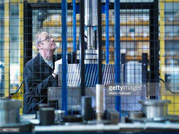 Engineer fixes gear to spindle in engineering factory
