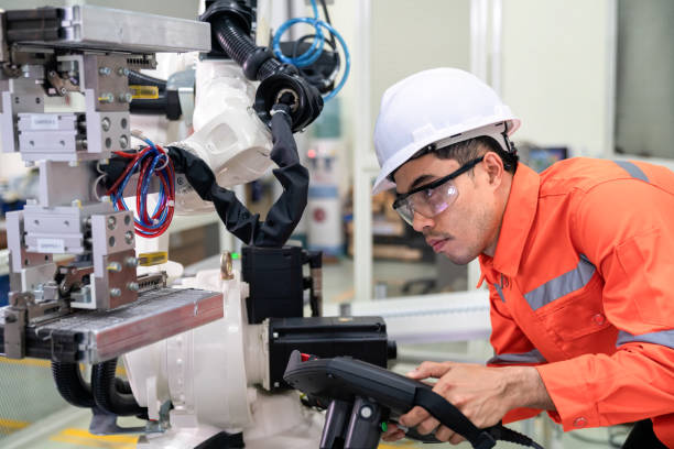 Engineer had checked the direction of robot after teaching in the automation factory.