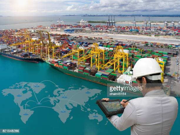engineer hold tablet to mangae business of transportation, engineer and business concept. - marine engineering stock photos and pictures