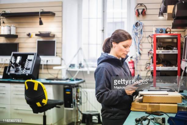 Engineer holding digital tablet in computer store