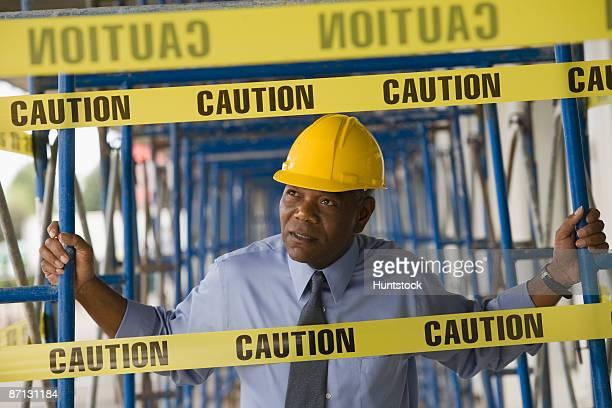engineer holding scaffoldings - the black tape project stock-fotos und bilder