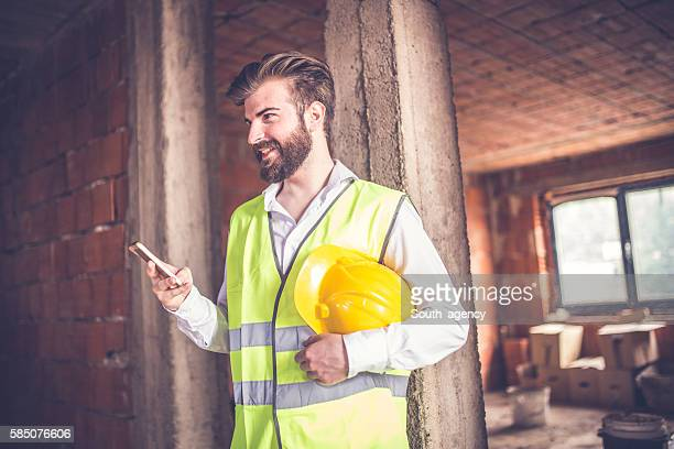 Engineer holding smart phone