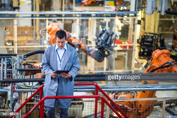 Engineer in a factory using a digital tablet