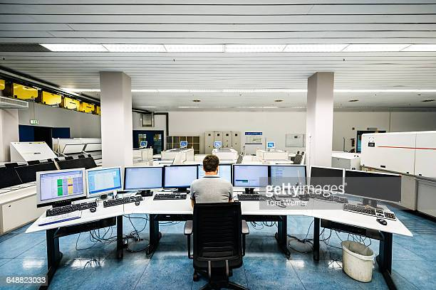 Engineer in a modern and clean control room