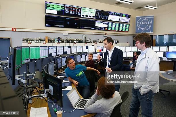 Engineer in charge of Operations Group Beams Department Mirko Pojer speaks to colleagues in the CERN Control Centre or CCC dedicated to the Large...