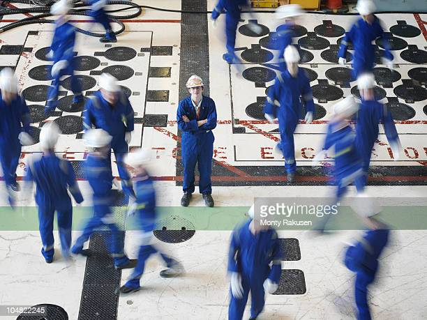 engineer in charging hall - white jumpsuit stock pictures, royalty-free photos & images