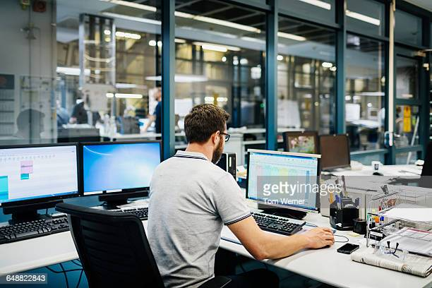 Engineer in control room of a factory