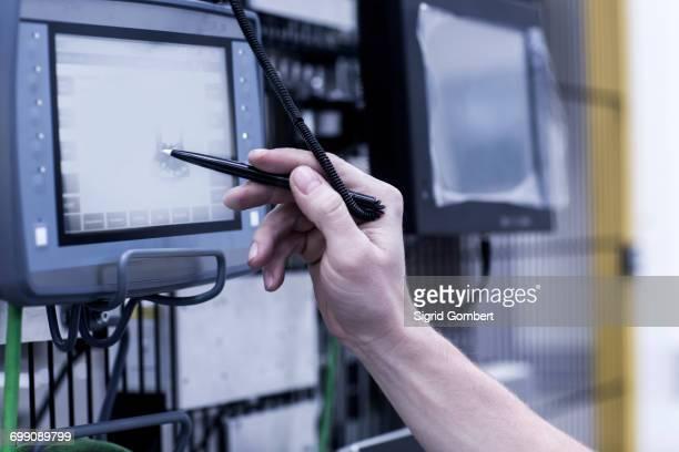 engineer in engineering plant, using stylus on screen, close-up - sigrid gombert stock-fotos und bilder