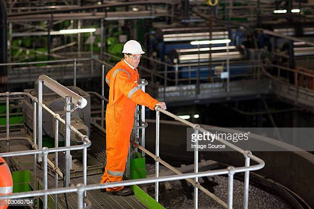 engineer in factory - railings stock photos and pictures