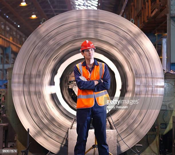 Engineer In Front Of Steel Lathe
