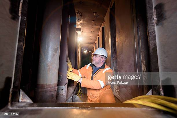 Engineer in furnace in gas-fired power station