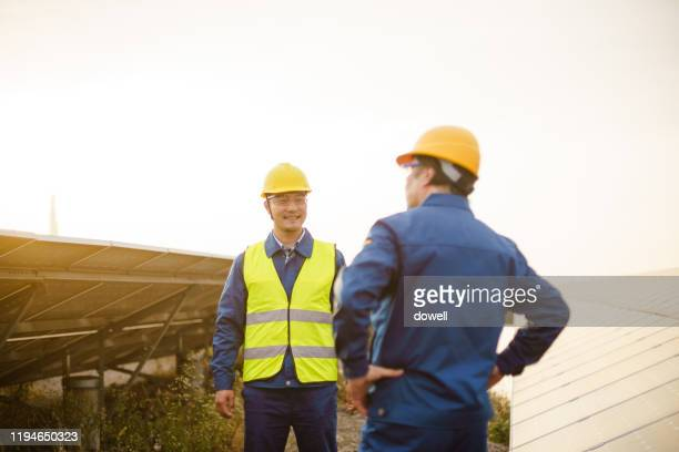 engineer in solar power station - power supply stock pictures, royalty-free photos & images