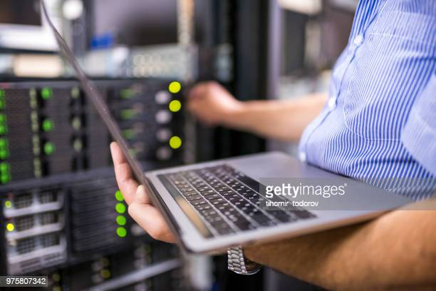 engineer in the server room close-up - data center stock pictures, royalty-free photos & images