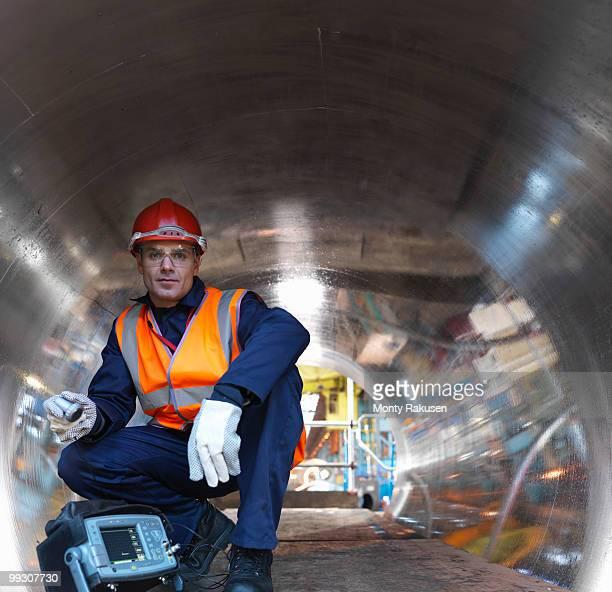 engineer in tunnel of forged steel - maschinenteil ausrüstung und geräte stock-fotos und bilder