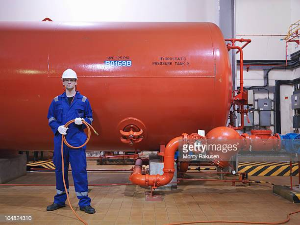 engineer in turbine hall - industrial hose stock pictures, royalty-free photos & images