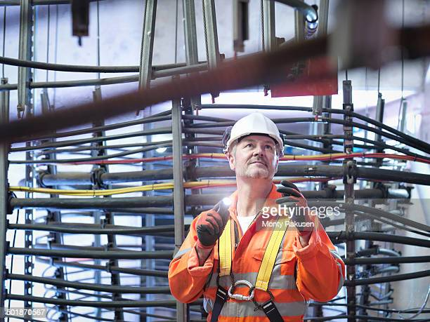 Engineer inspecting cable expansion in suspension bridge. The Humber Bridge, UK, built in 1981 was the world's largest single-span suspension bridge