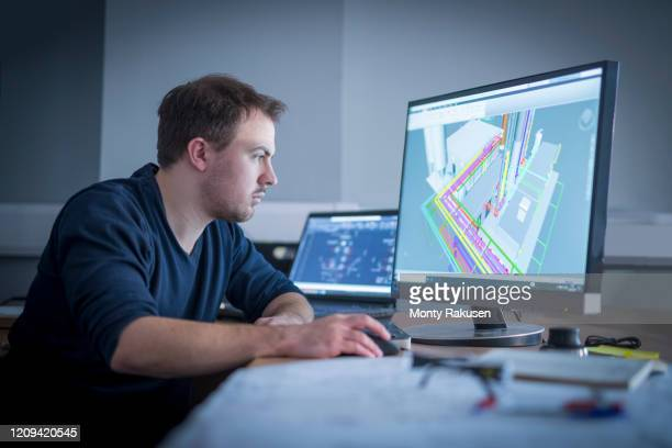 engineer inspecting cad drawing in metal fabrication factory. - accuracy stock pictures, royalty-free photos & images