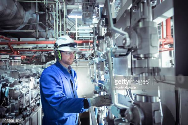 engineer inspecting equipment in a nuclear power station. - atomic imagery stock pictures, royalty-free photos & images