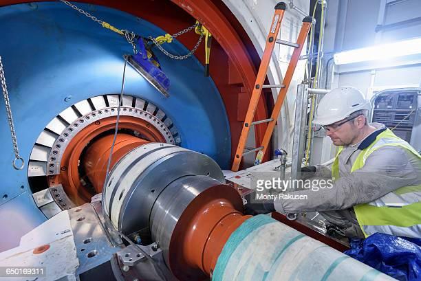 engineer inspecting equipment in gas-fired power station - monty rakusen stock-fotos und bilder