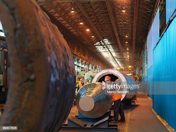 Engineer Inspecting Forged Steel Roller
