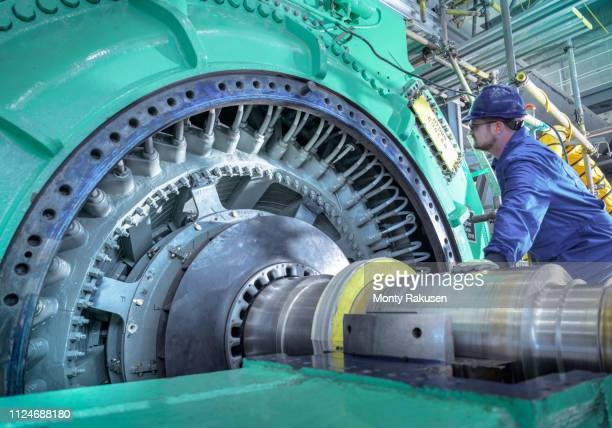 engineer inspecting generator in nuclear power station during outage - generator stock pictures, royalty-free photos & images