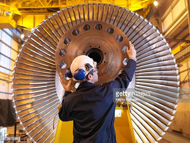 Engineer Inspecting Turbine