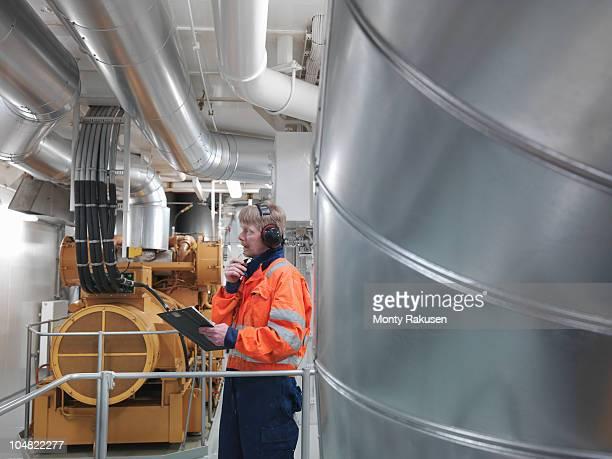 Engineer inspects generator