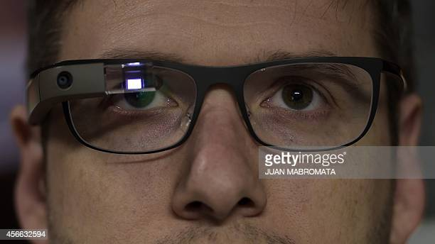 Engineer Julian Rousselot wears the Google glasses at the computer science lab of the UADE in Buenos Aires on September 23 2014 AFP PHOTO / JUAN...