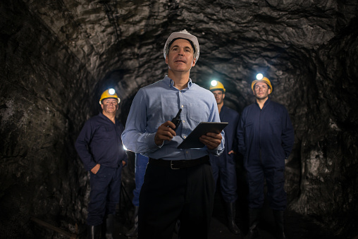Engineer leading a group of miners 491514960