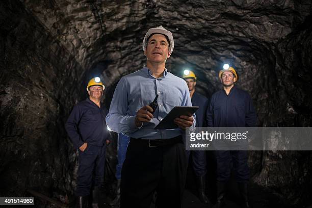 engineer leading a group of miners - gruva bildbanksfoton och bilder