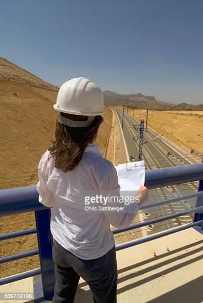 Engineer Looking at New Railroad