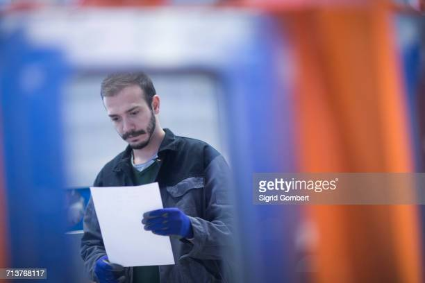 engineer looking at paperwork - sigrid gombert stock pictures, royalty-free photos & images