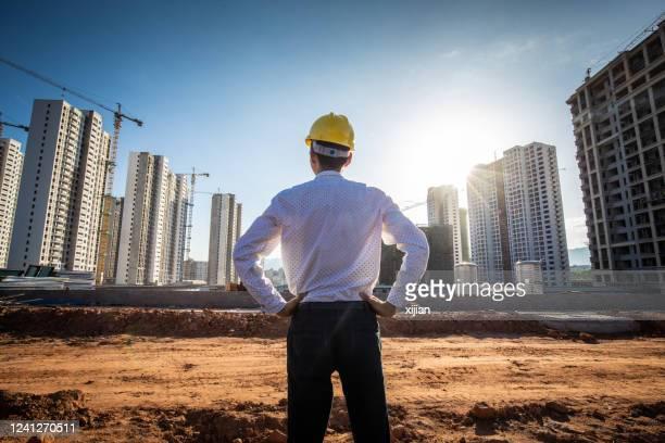 engenheiro procurando construção - built structure - fotografias e filmes do acervo