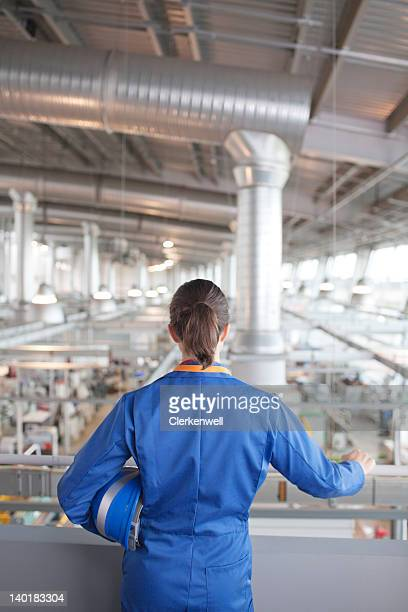 engineer looking down on factory - coveralls stock pictures, royalty-free photos & images