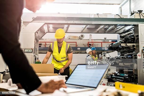 Engineer looking something on laptop