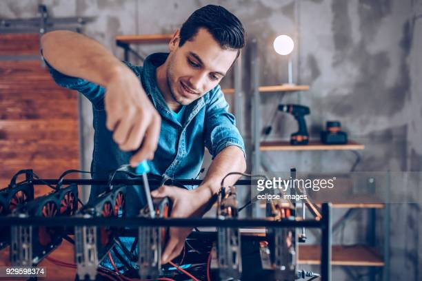 Engineer making cryptocurrency machine
