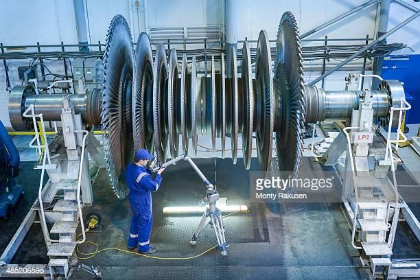 Engineer measuring low pressure steam turbine parts in repair works