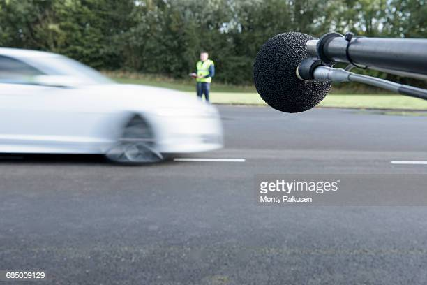 engineer measuring vehicle sound level at test track - test track stock pictures, royalty-free photos & images