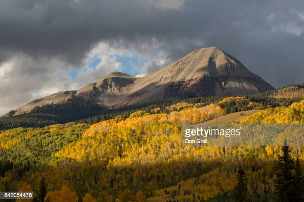 engineer mt catches late afternoon sun on an autumn day in colorado - san juan mountains stock photos and pictures