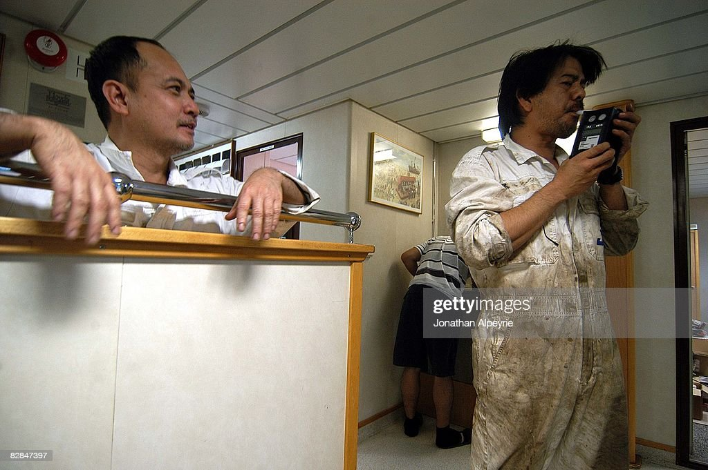 Engineer officers are asked to blow on a liquor test device to make sure none are drunk during work hours, on July 21, 2008, in France. The company will send an E-mail to the captain in order for him to organize a surprise checking.