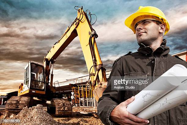 engineer on construction site - excavator stock photos and pictures